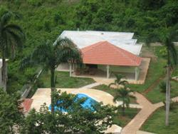 Gated Housing Project, 3 homes surrounding Pool.